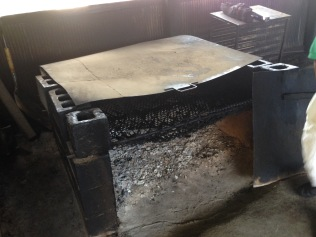Pit for smoking meat